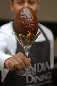"""India Dining owner Asad Khan with the """"Not for Bunnies"""" Easter egg"""