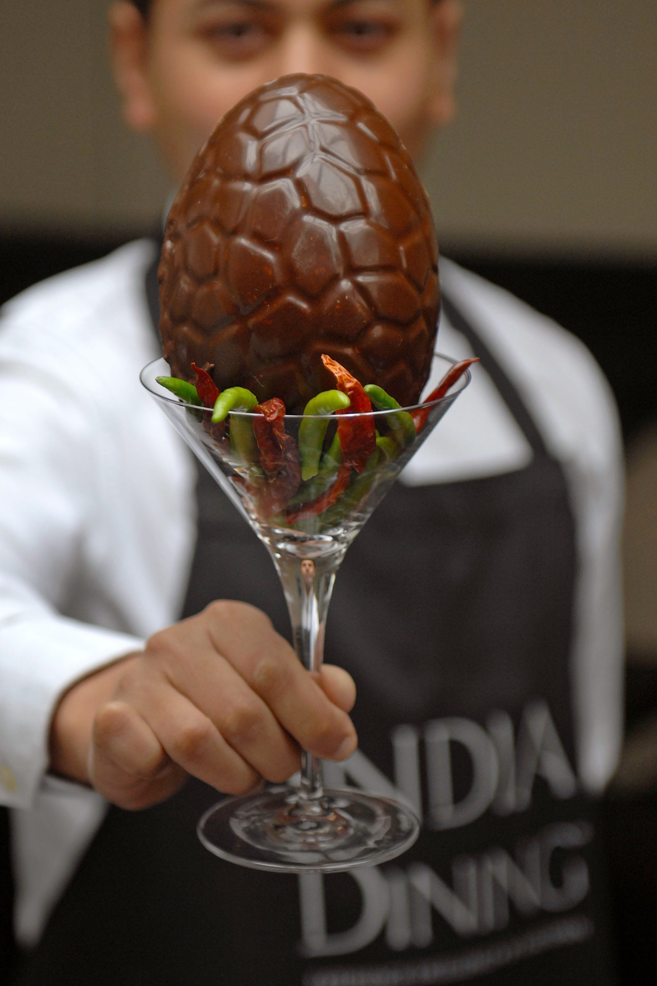 "India Dining owner Asad Khan with the ""Not for Bunnies"" Easter egg"