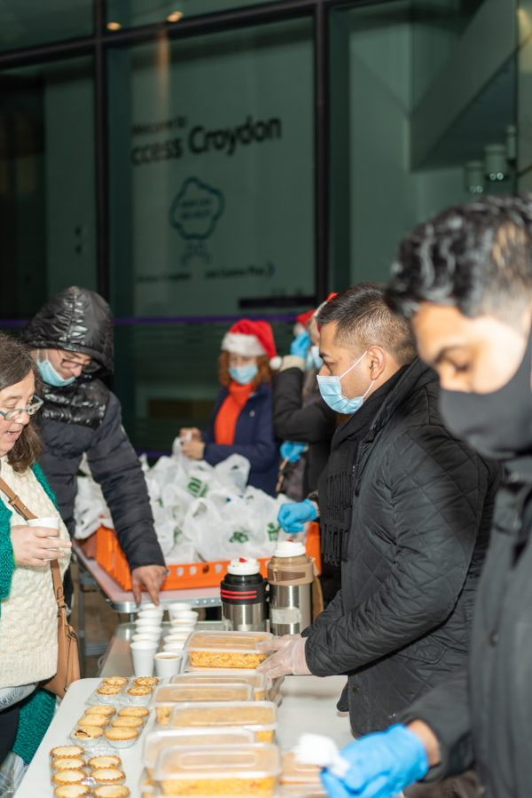 Distributing curry to the vulnerable and homeless