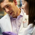 Dr Euan Ashley in the lab with colleague